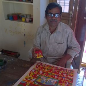Mr Vykuntam with the medal and other Cheriyal paintings